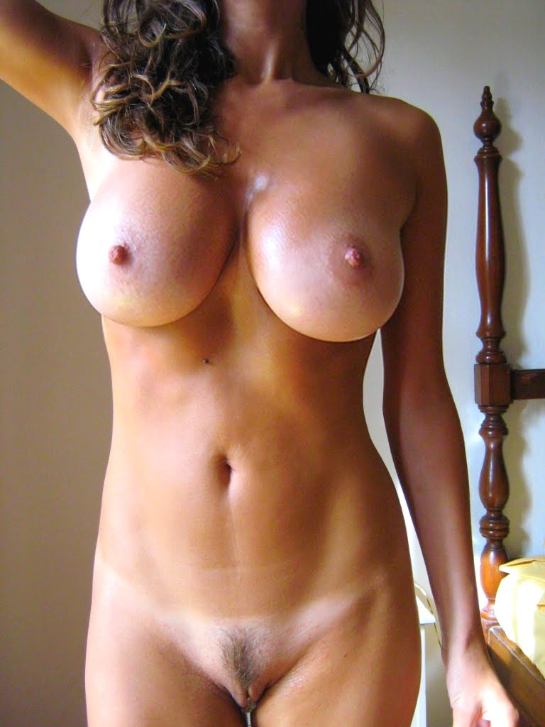 Naked oiled busty babe